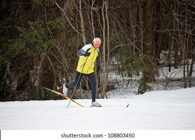 senior in winter on snow with skis cross-country skiing