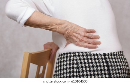 Senior woman of 80 years old with a pain in low back
