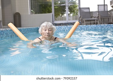 Senior woman aqua fitness
