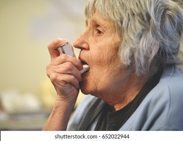 Senior woman with asthma inhale