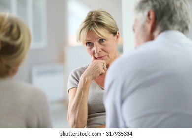 Senior woman attending group therapy