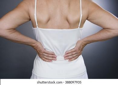 A senior woman with backache