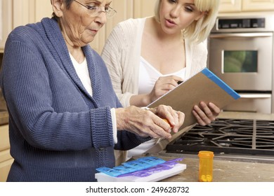 Senior Woman being helped with organizing prescription medicine by a young caregiver.