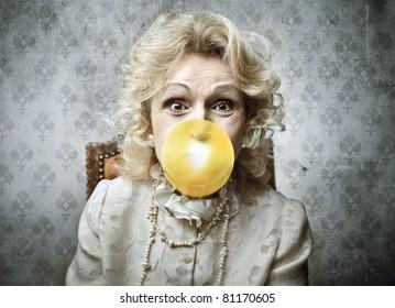 Senior woman blowing a bubblegum