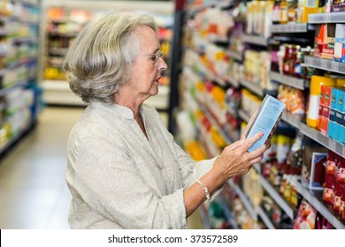 Senior woman buying food at the supermarket