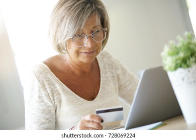 Senior woman buying on internet with credit card