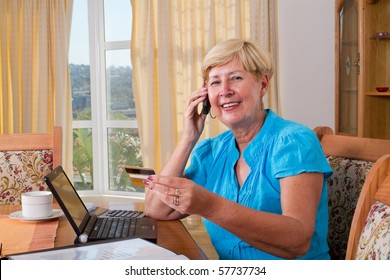 senior woman buying online and paying with credit card