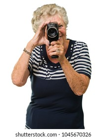Senior Woman Capturing Photo On White Background