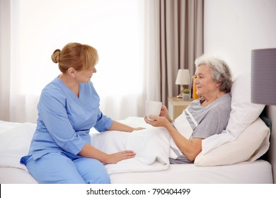 Senior woman with caregiver at home