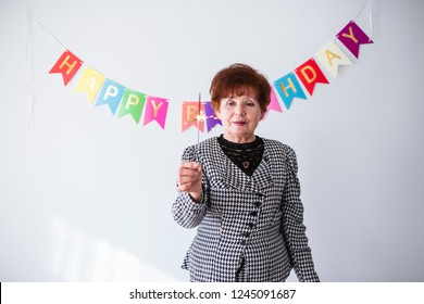Senior woman celebrating her birthay at home