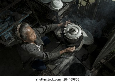 Senior woman chef cooks in the kitchen, Lifestyle of Asian old women concept