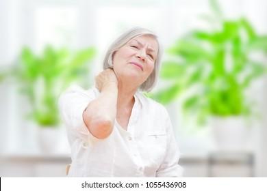 Senior woman with chronic pain syndrome fibromyalgia suffering from acute neckaches
