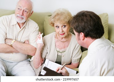 Senior woman complaining to a marriage counselor about her husband.