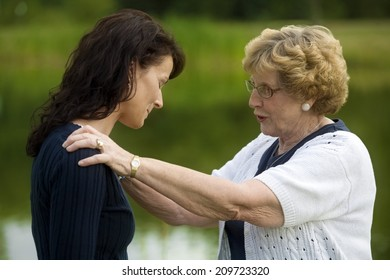 Senior Woman Consoling Her Daughter