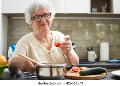 Senior woman cooking in the kitchen.