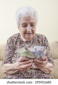 senior woman counting money (euros)