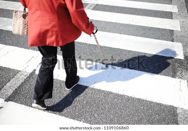 Senior woman crossing