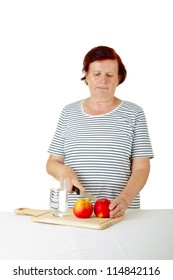 senior woman cutting fresh apples