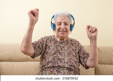 senior woman dancing while listening music