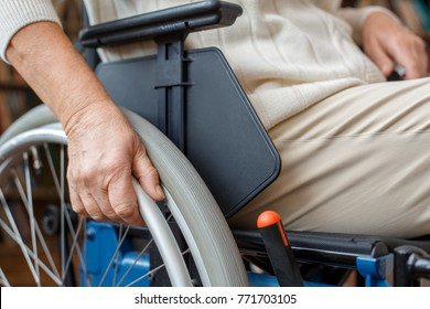 Senior woman with disability recovery at home in a wheelchair close-up