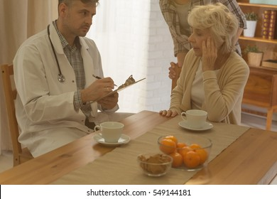 Senior woman and doctor during private home visit