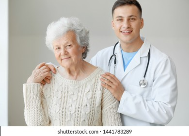Senior woman with doctor in hospital