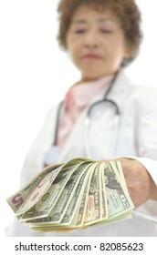 Senior woman doctor receiving money