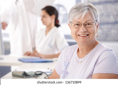 Senior woman at doctor's room waiting for examination.
