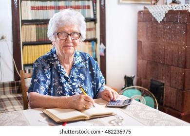 Senior woman doing finances at home.