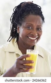 Senior Woman Drinking Fresh Orange Juice