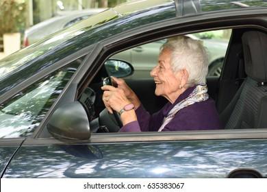 senior-woman-driving-car-260nw-635383067.jpg