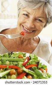 Senior Woman Eating Healthy Salad