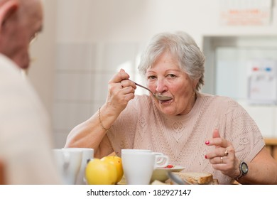 senior woman eating her lunch at home
