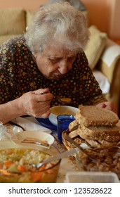 senior woman eating her lunch/dinner at home