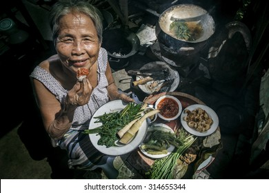 Senior woman eating in the kitchen, Lifestyle of Asian old women concept