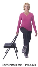 Senior woman exercising with chair