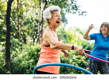 Senior woman exercising with a hula hoop