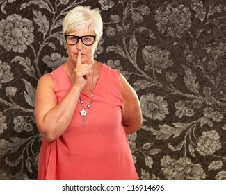Senior Woman With Finger On Lips, Indoor