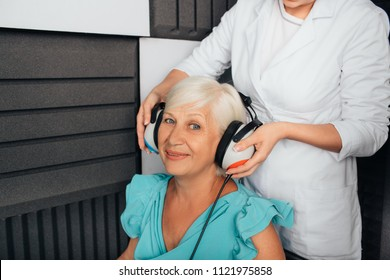 Senior woman getting a hearing test at a doctors office, audiometer hearing test