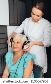 Senior woman getting a hearing test at special audio room, audiometer hearing test