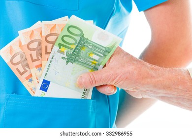 Senior woman giving soap money to doctor - healthcare costs concept.