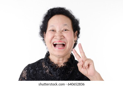 Senior woman with glad expression over white background