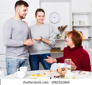 Senior woman glad to get acquainted with future husband of her daughter