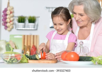 Senior woman with granddaughter cooking