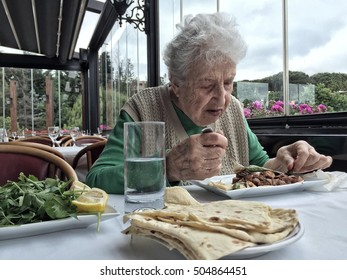 senior woman having lunch in a restaurant