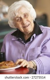 Senior woman having morning tea