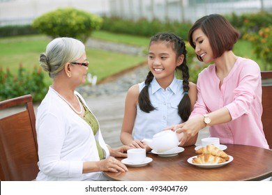 Senior woman having tea with her daughter and granddaughter