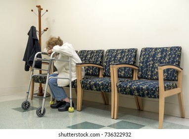 senior woman with head resting on walker sitting in waiting room