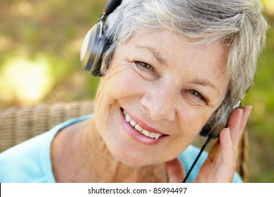 Senior woman with headphone