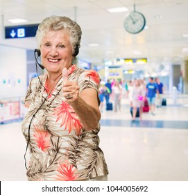 Senior Woman With Headset Showing Thumb-up Sign, Indoors